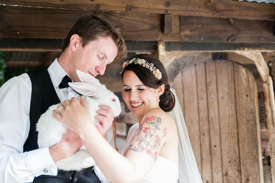 This rabbit grabs the attention instead of the newlyweds.